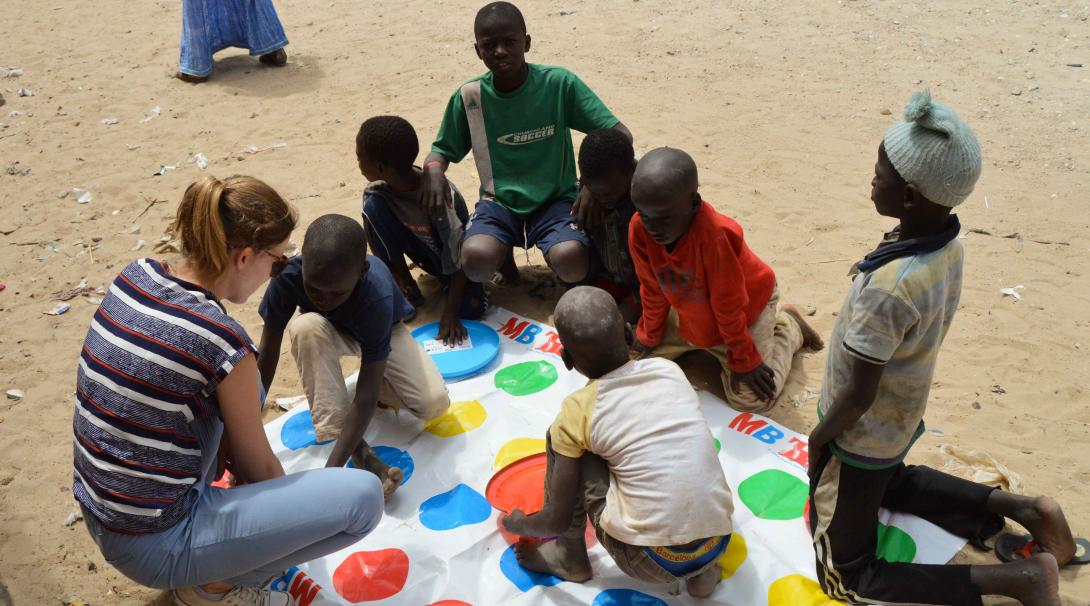 A Projects Abroad volunteer is working with children in Senegal during her High School Special summer program.